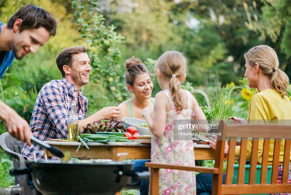 Family At Barbeque In A Garden : Stock Photo