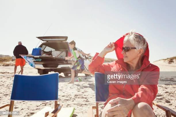 Family at beach against clear sky