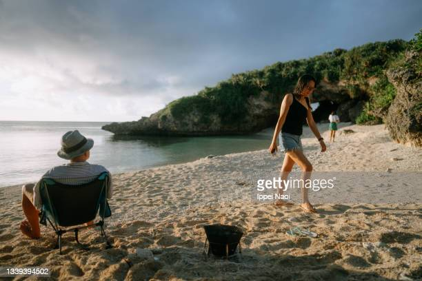 family at beach campsite at sunset - tropical climate stock pictures, royalty-free photos & images