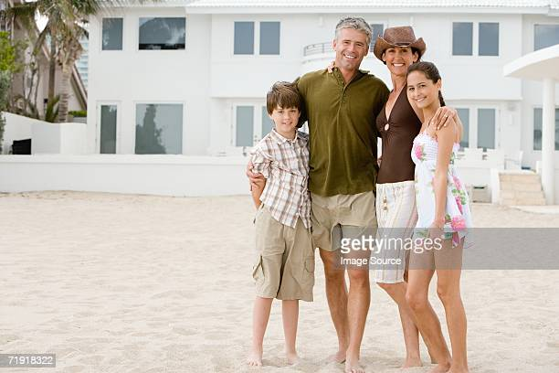 family at beach house - beach house stock pictures, royalty-free photos & images