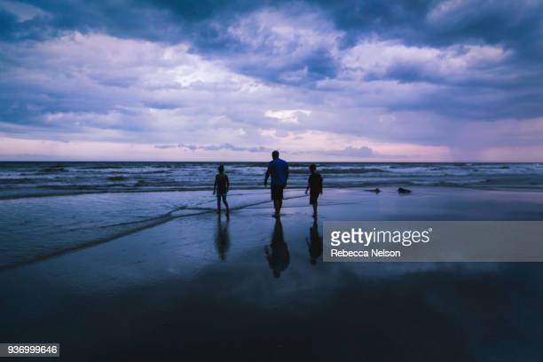 family at beach on overcast night
