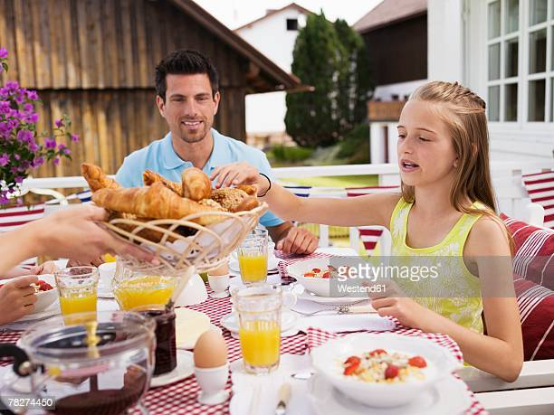 Father and daughter (10-11) at dinning table