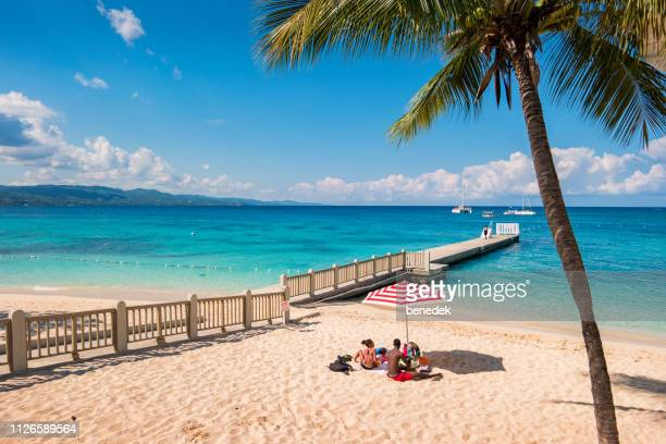 family at doctor's cave beach in montego bay jamaica - jamaica stock pictures, royalty-free photos & images