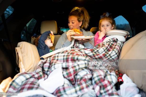family at drive-in movie - autokino stock-fotos und bilder