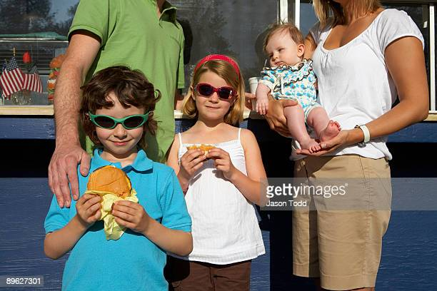 family at hamburger stand  - jason todd stock photos and pictures