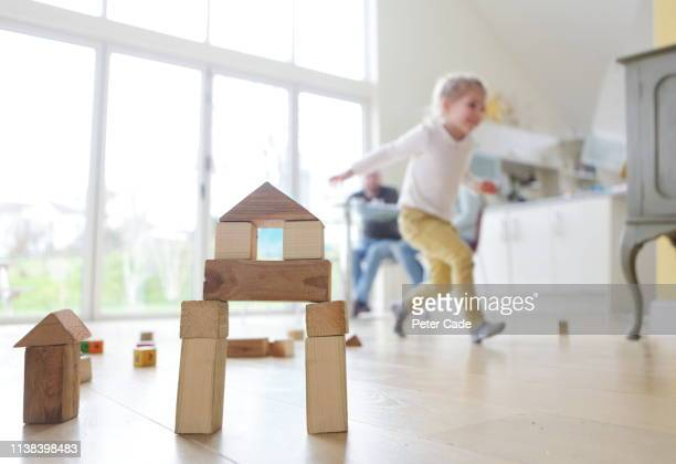 family at home, child playing with building blocks - caucasian ethnicity stock pictures, royalty-free photos & images
