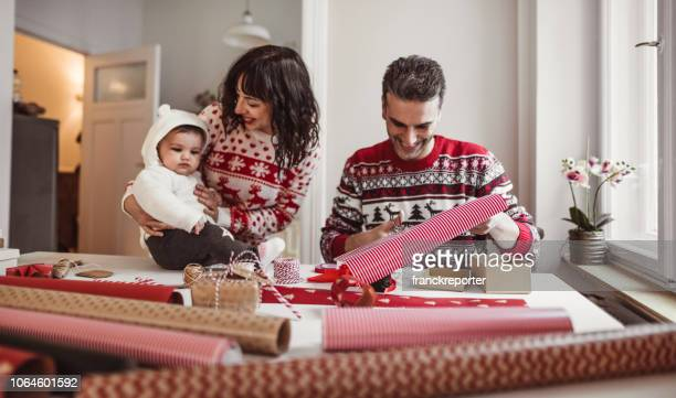 family at home creating christmas gifts - happy new month stock photos and pictures