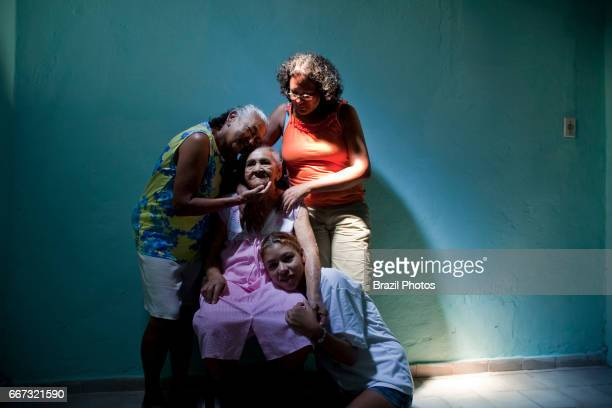 Family at home four generations only women Brazil