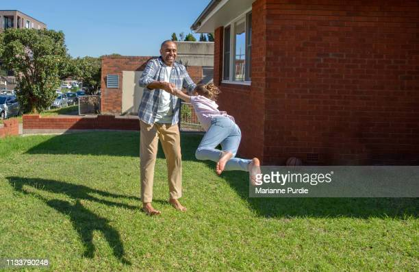 a family at home - thisisaustralia stock pictures, royalty-free photos & images