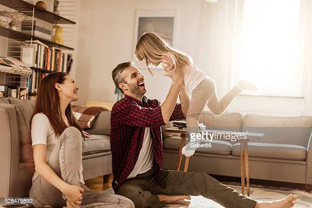 family at home - family at home stock pictures, royalty-free photos & images