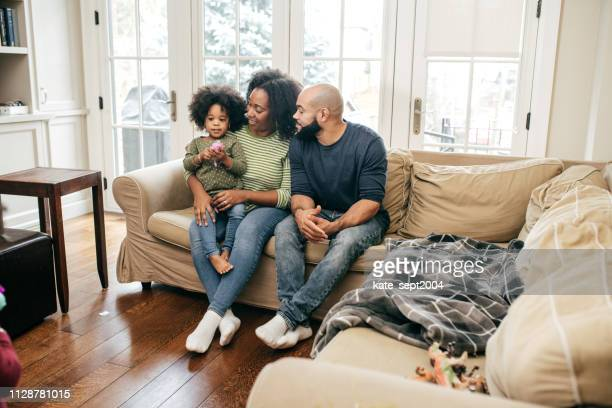 family at home with two kids - family at home stock pictures, royalty-free photos & images