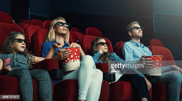 family at movie theatre. - children theatre stock photos and pictures