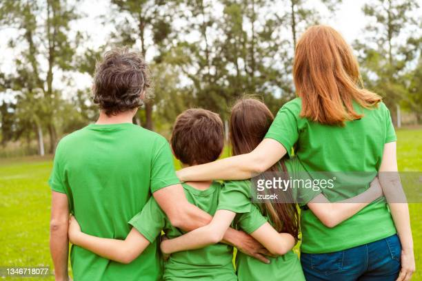 family at park during environmental cleanup - izusek stock pictures, royalty-free photos & images