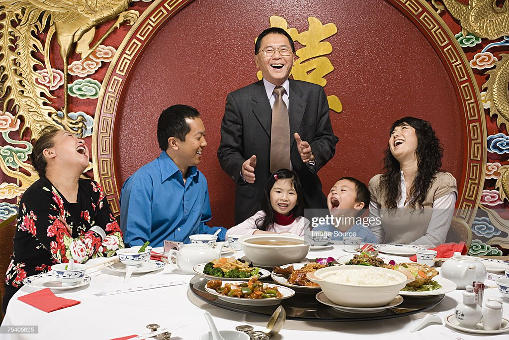 Family at reunion dinner : Stock Photo