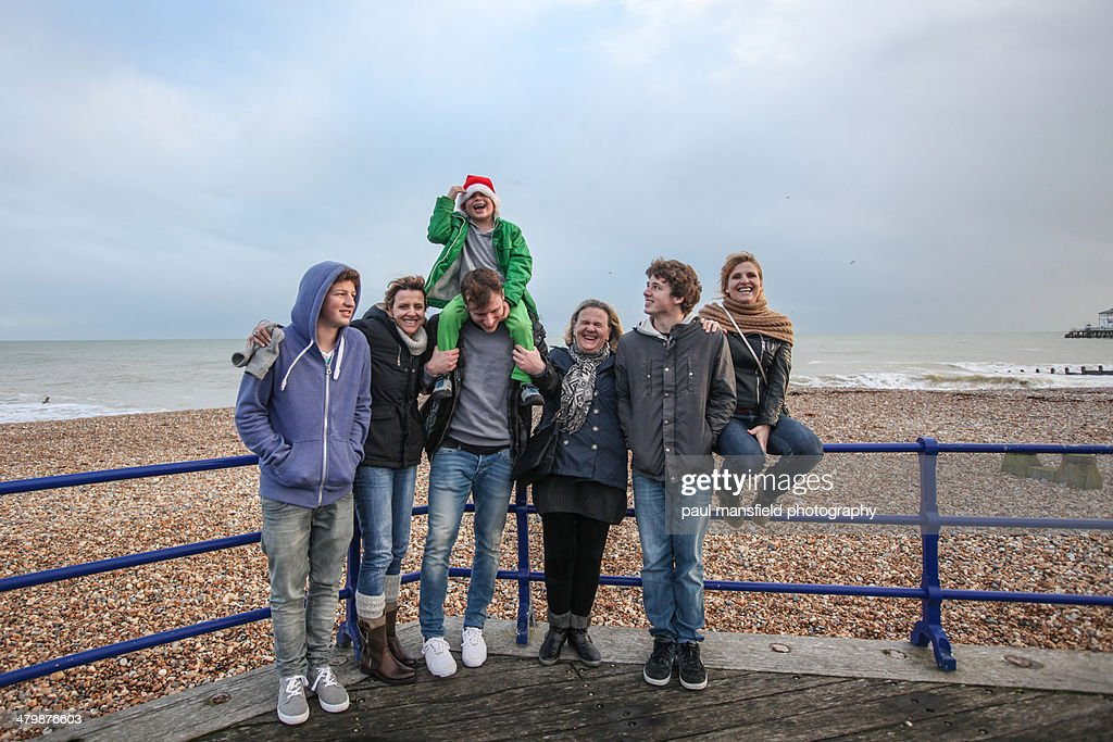 Family at seaside on wintry day : Stock Photo