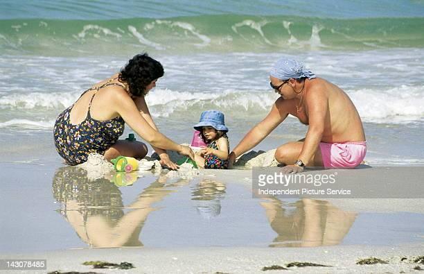 Family at Siesta Key Beach, Sarasota, Florida.