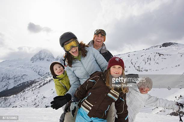 family at ski resort - winter sport photos et images de collection