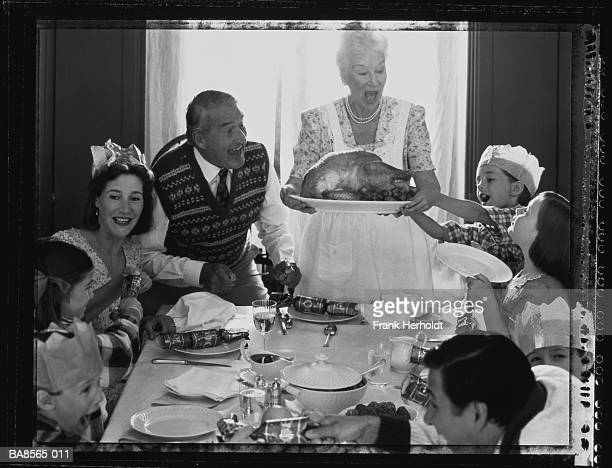 Family at table for Christmas lunch (toned Polaroid B&W)