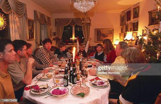 Family at table for traditional Christmas dinner.