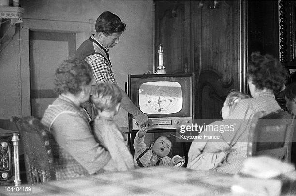 A family at table in front of the television set in the 1960's in France It was during this time that the French households began to equiped...