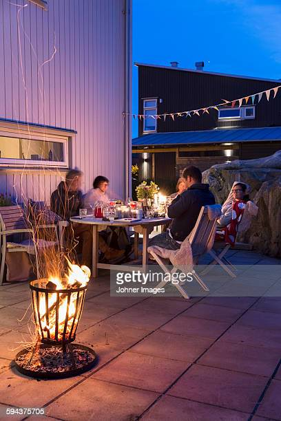 Family at table on backyard