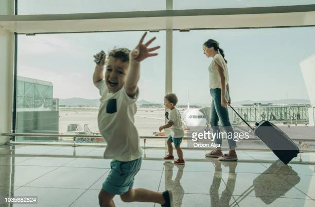 family at the airport - kid in airport stock pictures, royalty-free photos & images