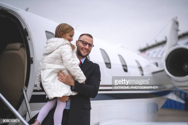 family at the airport - airplane part stock photos and pictures