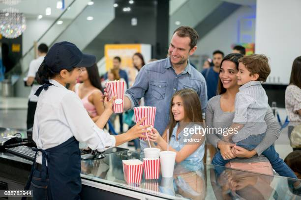 Family at the cinema buying food at the candy shop