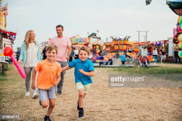 family at the fairground - carnival stock photos and pictures
