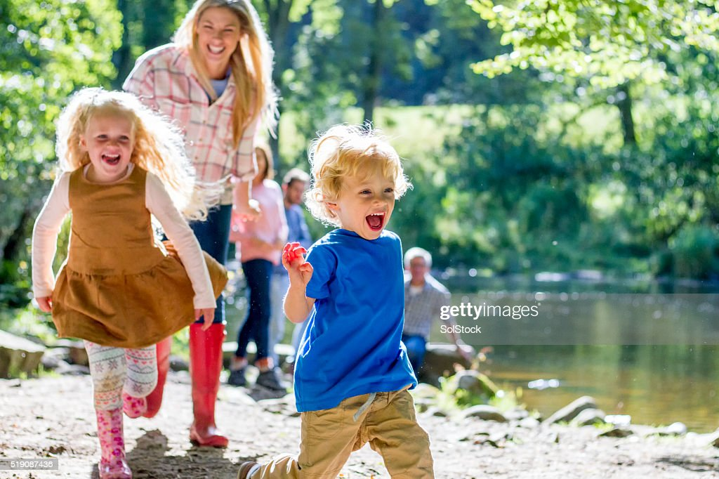 Family at the lake : Stock Photo