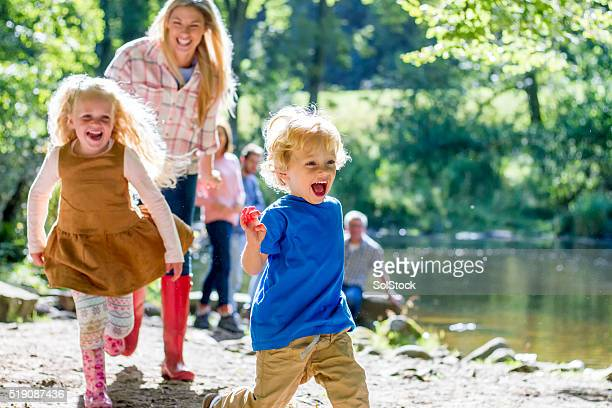 family at the lake - standing water stock pictures, royalty-free photos & images