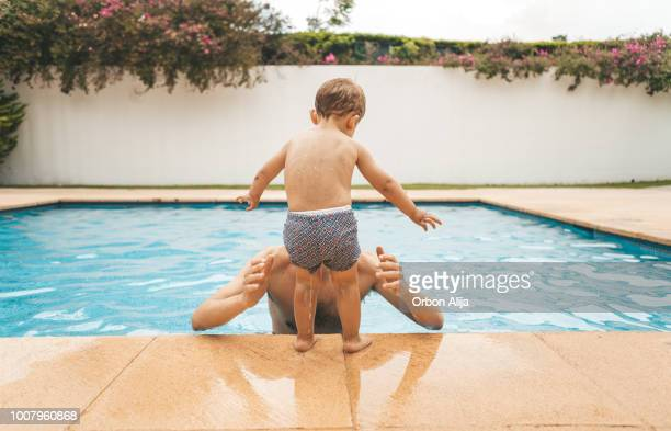 family at the pool - leap day stock pictures, royalty-free photos & images
