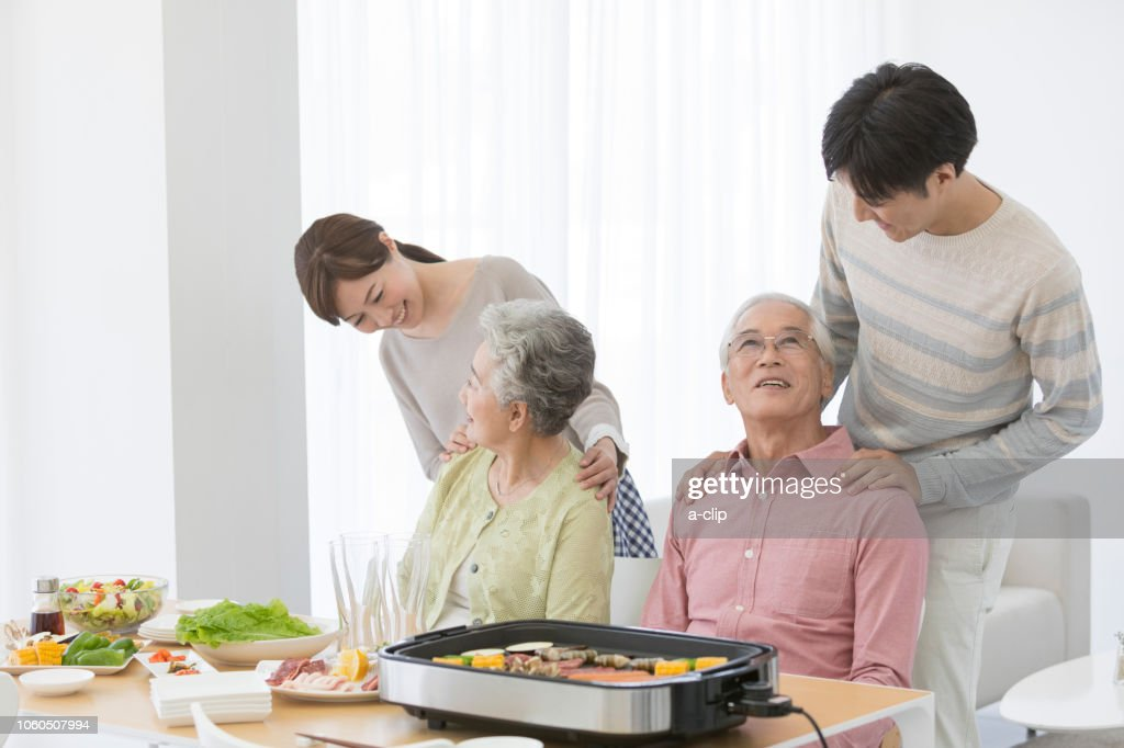 A family at the table : Stock Photo