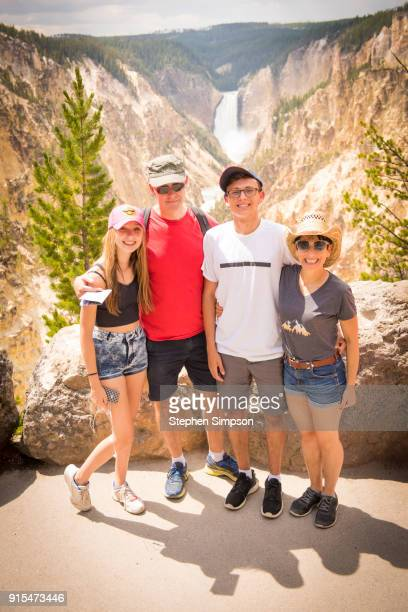 family at waterfall at yellowstone national park - yellowstone river stock photos and pictures