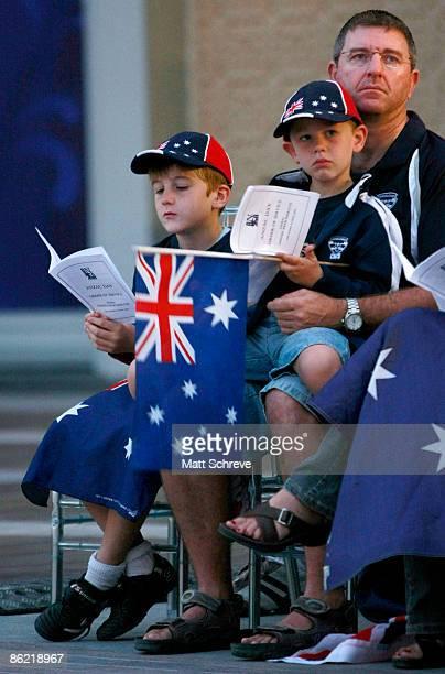 A family attends the dawn ceremony for ANZAC Day near the Burj Dubai on April 25 2009 Dubai United Arab Emirates ANZAC Day originally commemorates...