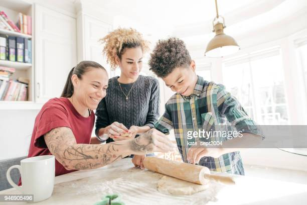 LGBTQ family baking cookies together