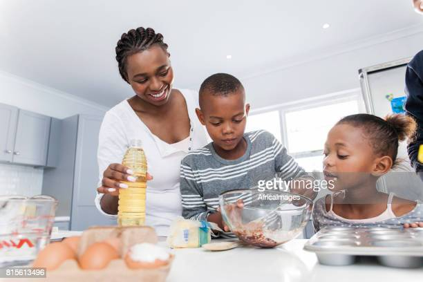 Family baking muffins together.