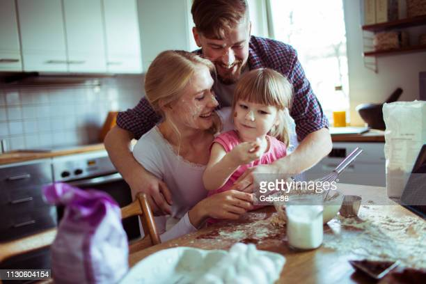 family baking - northern european descent stock pictures, royalty-free photos & images