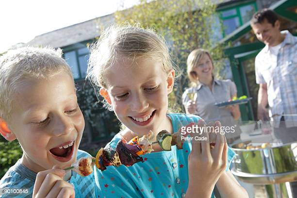 family barbeque, children eating