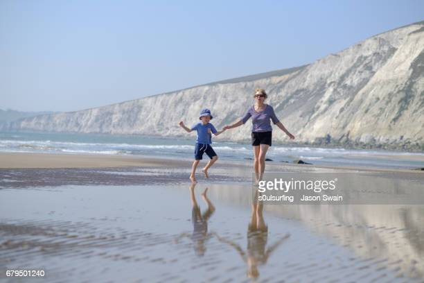 family beach time - compton bay isle of wight stock pictures, royalty-free photos & images