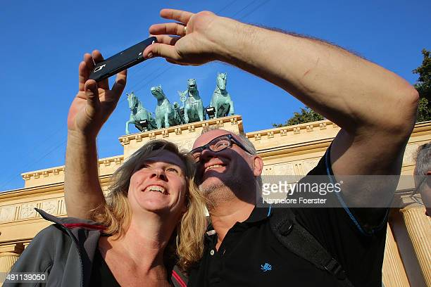 Family Becker takes a selfie in front of the little Brandenburg gate at the 25th anniversary citicen festival of German reunification on October 3...