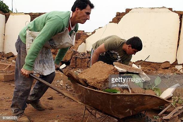 A family begins the process of trying to repair their home damage by the Feb 27th earthquake on March 13 2010 in San Pedro De Alcantara Chile The...