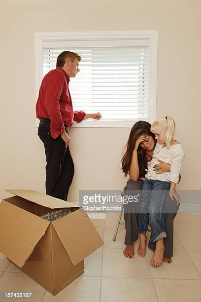 Family being evicted from their home. Empty room, moving box.