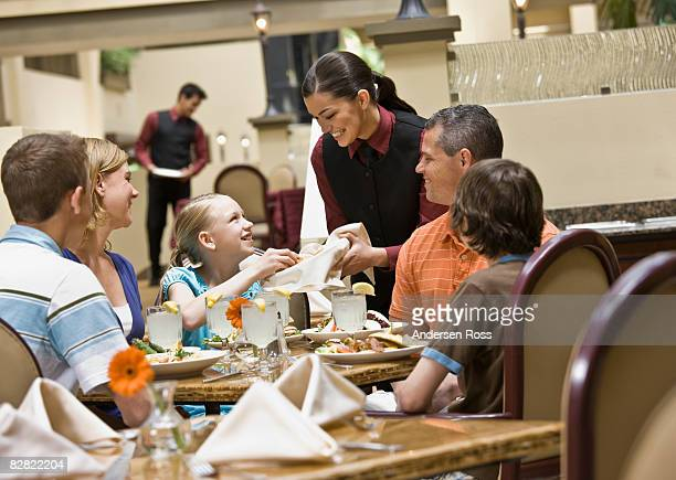 Family being served at a hotel restaurant