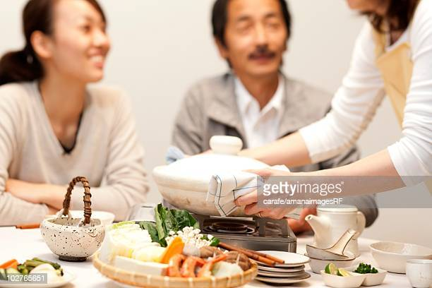 Family being served dinner at table