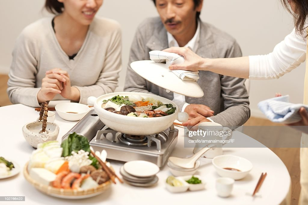 Family being served dinner at table : Stock Photo