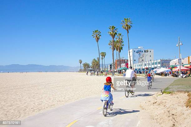 family bicycling on path near beach, venice - malibu stock pictures, royalty-free photos & images