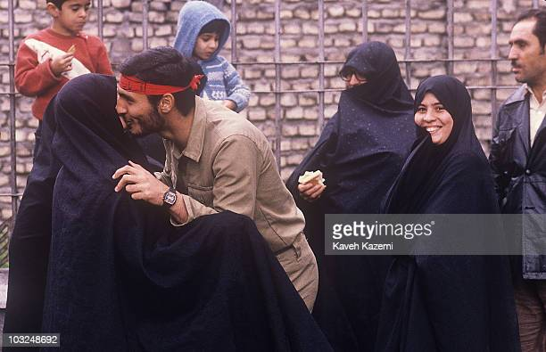 Family bids farewell to a Basiji member in Tehran, Iran, before his departure for the war front with Iraq, 12th February 1988.