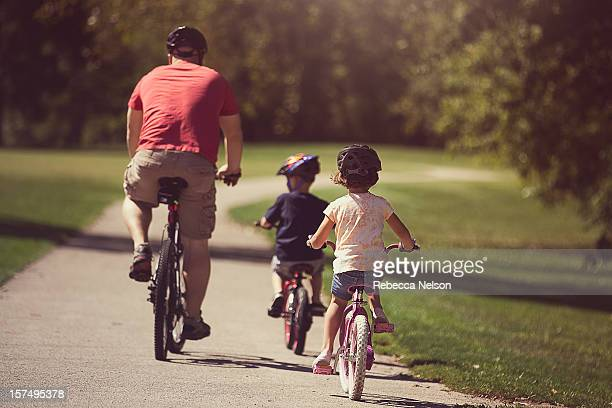 family bike ride - rebecca nelson stock pictures, royalty-free photos & images