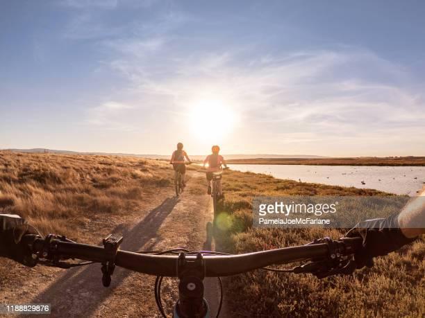 pov of family biking along shoreline trail, california, usa - santa clara county california stock pictures, royalty-free photos & images